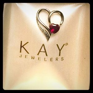 Kay Jewelers Silver pendant with red gem